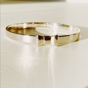 Kate Spade Silver Bow Bangle.  Comes with Kate spade jewelry bag